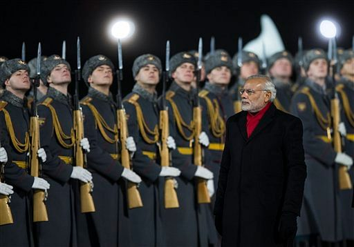 Indian Prime Minister Narendra Modi, reviews an honour guard upon arrival at Moscow's Government Vnukovo II Airport outside Moscow, Russia. (Photo: AP)