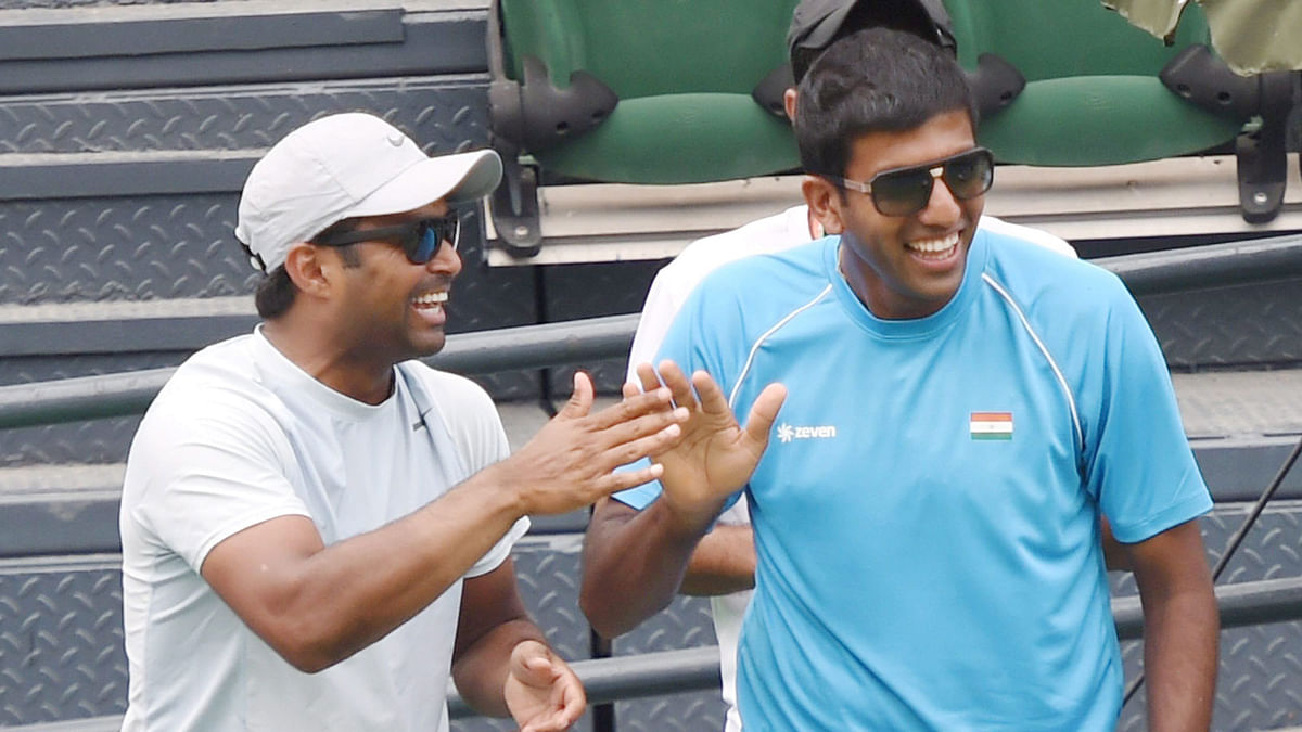 Leander Paes and Rohan Bopanna cheer on the Indian team from the stands during a Davis Cup fixture in India (Photo: PTI)