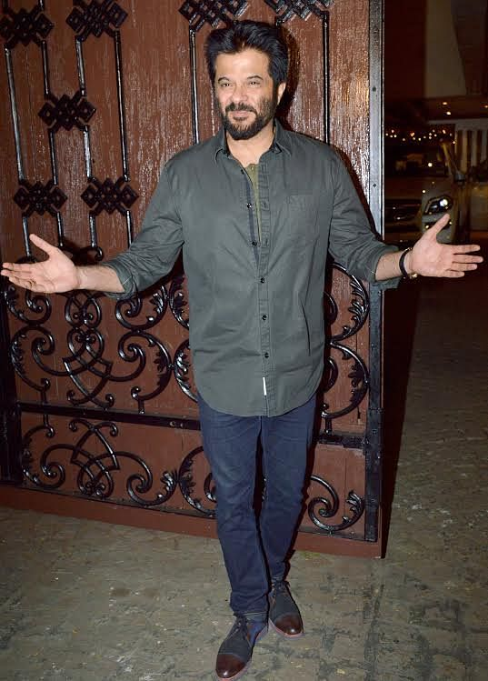 Birthday boy Anil Kapoor welcomes his guests (Photo: Yogen Shah)