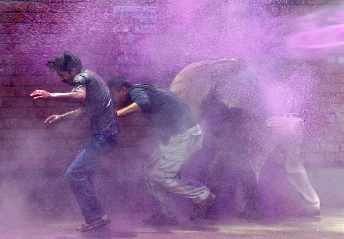 Kashmiri govt employees hit by water cannon during a protest in Srinagar June 10, 2008. (Photo: Reuters)