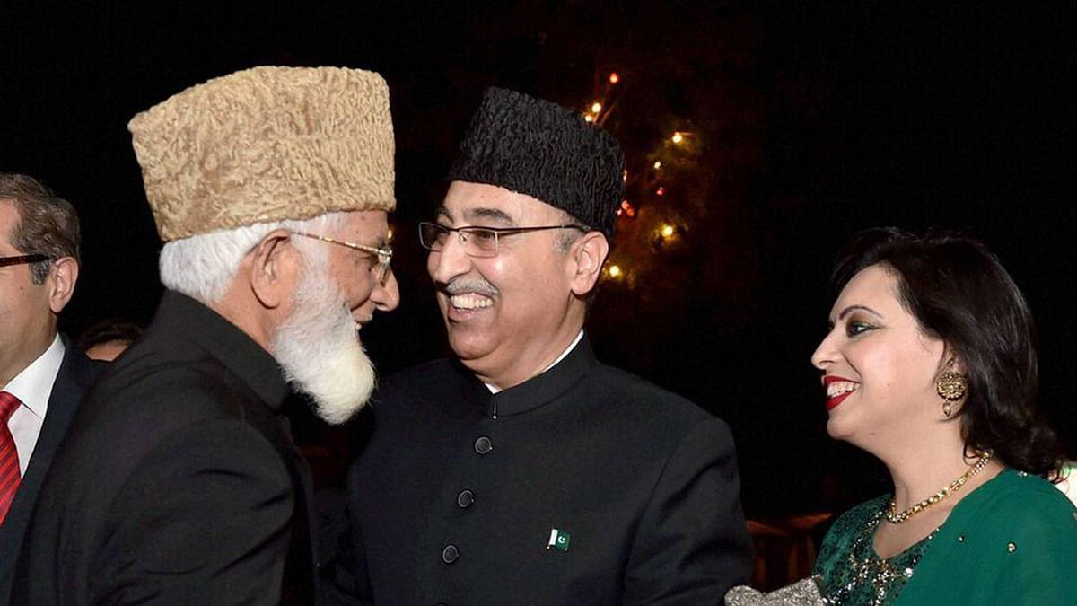 File photo of Pakistani High Commissioner to India Abdul Basit (C) with Hurriyat leader Syed Ali Shah Geelani at the Pakistan High Commission in New Delhi. (Photo: PTI)