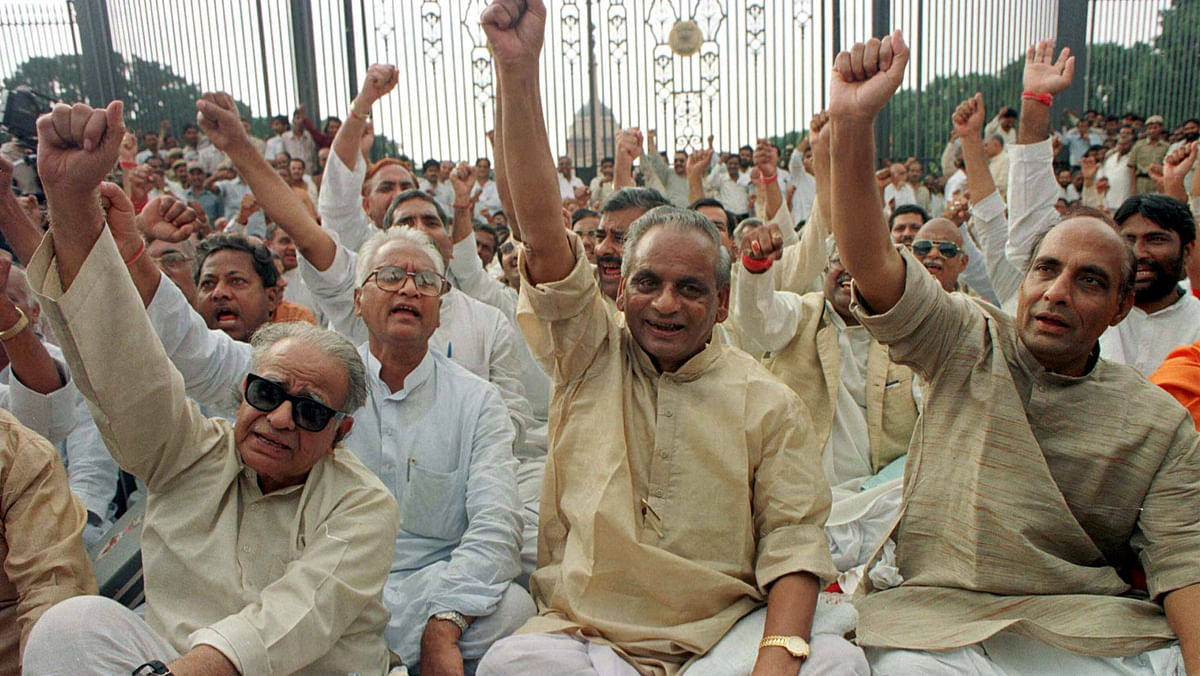 """Kalyan Singh (Centre) warned the state police not to use force against the kar sevaks who continued to make structural changes to the buildings located in the 2.77 acre acquired by his government for """"tourist activities"""". (Photo: Reuters)"""
