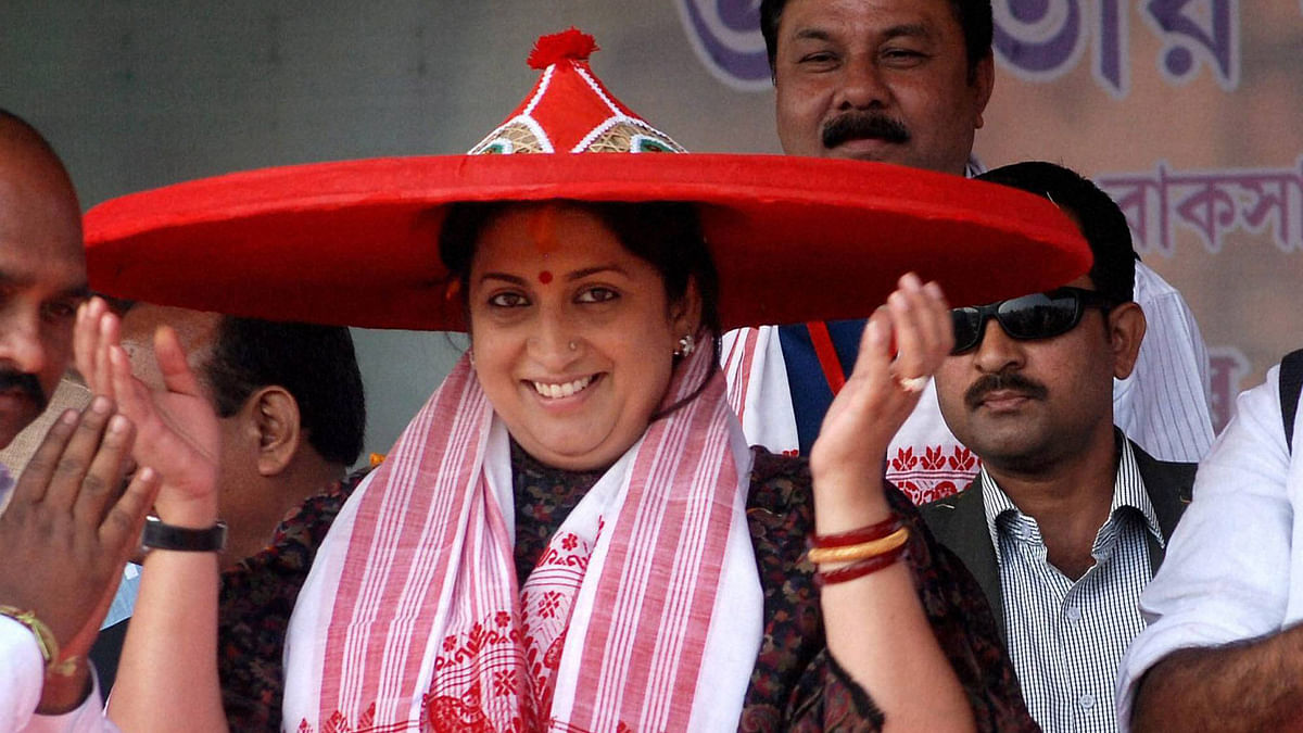 HRD Minister Smriti Irani being felicitated with an Assamese <i>japi</i> during a public meeting in Nalbari on Monday. (Photo: PTI)