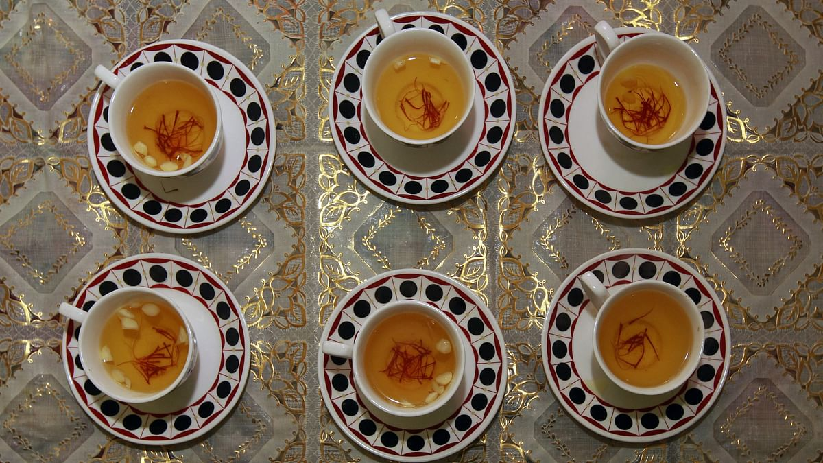 Dried saffron and almonds seen in cups filled with <i>kahwa</i>, a traditional Kashmiri sweet tea, in Srinagar. (Photo: Reuters)
