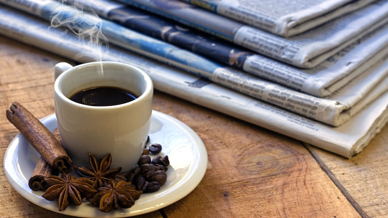 Nothing like a cup of coffee and your Sunday morning reads. (Photo: iStock)