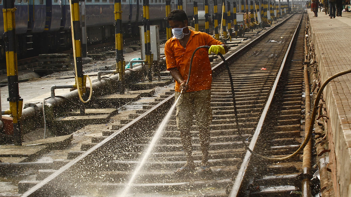 Open defecation along railway tracks and roads are a problem in urban India as well. A worker cleans a railway track at a railway station in Kolkata. (Photo: Reuters)