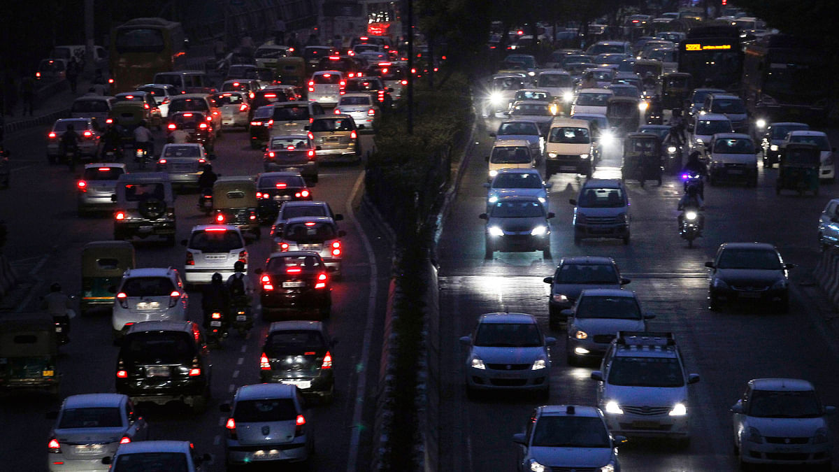 Heavy traffic moves along a  busy road on an evening in New Delhi. (Photo: Reuters)