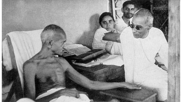 """Mohandas Karamchand  Gandhi in a discussion with C Rajagopalachari at Sevagram, June 1940. (Photo courtesy: <a href=""""https://twitter.com/ArchiveIndia"""">@ArchiveIndia</a>)"""