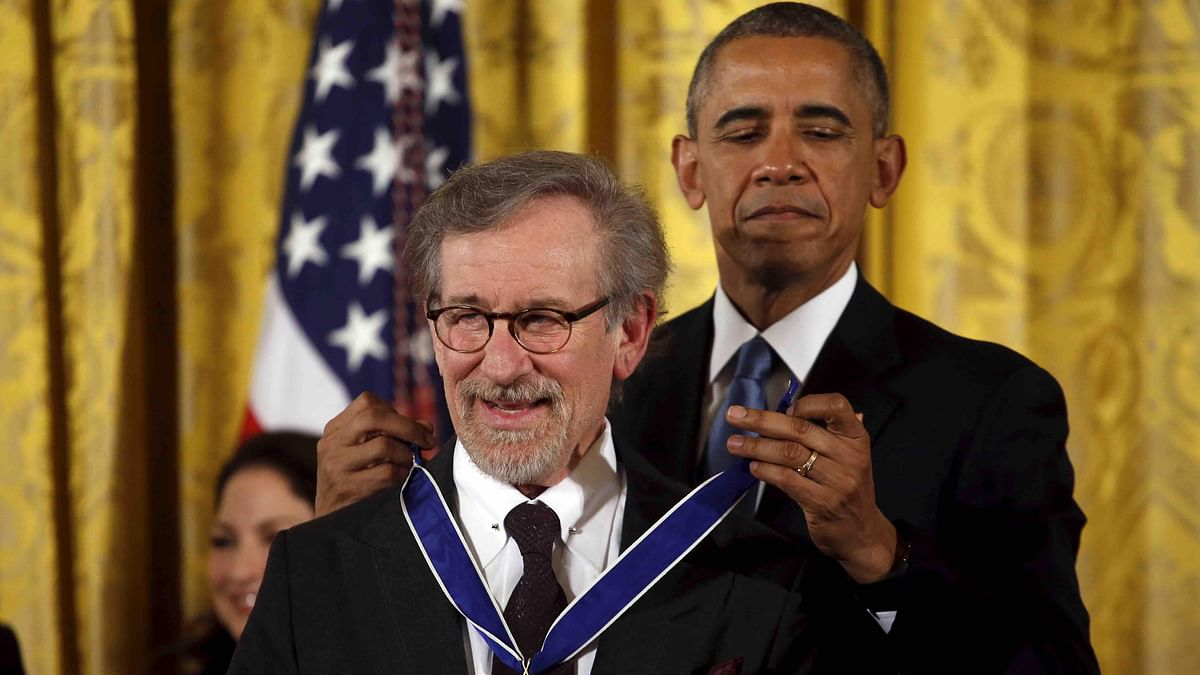 US President Barack Obama presents the Presidential Medal of Freedom to film director Steven Spielberg during an event in the East Room of the White House in Washington on November 24, 2015.