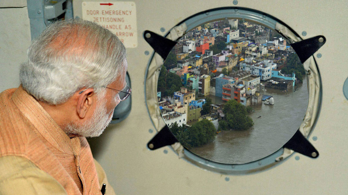 This Photoshopped image of PM Modi on a flood survey was tweeted by PIB on Dec 3, 2015. (Photo: PTI)