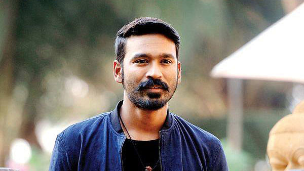 """The couple had alleged that the actor was their elder son, Kalaichelvan who was born to them in 1985 in Madurai. (Photo Courtesy: Facebook/<a href=""""https://www.facebook.com/DhanushKRaja/photos/pb.671503962922594.-2207520000.1443559025./827655373974118/?type=3&amp;theater"""">@Dhanush</a>)"""