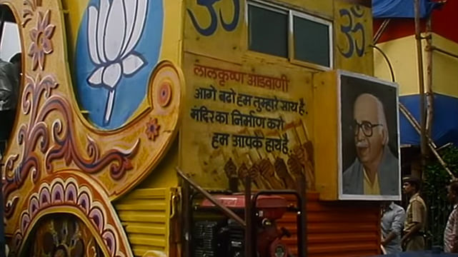 """Slogan painted on the back of Advani's rath read, """"Go forward, we are with you. Progress towards a temple, we will be your hands"""". (Photo: Screen grab/Ram Ke Naam)"""