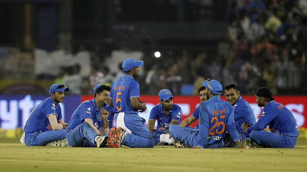 The Indian cricket team sits in a circle and waits for the crowd's heroics to subside. (Photo: Reuters)