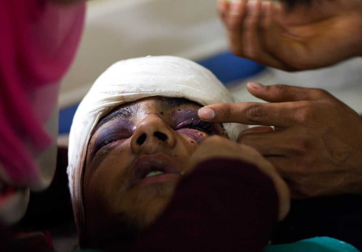 Hamid Nazir injured in pellet-firing by paramilitary forces to disperse a protest in Palhalan, Kashmir, on May 21 2015, death anniversary of Mirwaiz Mohammad Farooq. (Photo: Shahid Tantray)