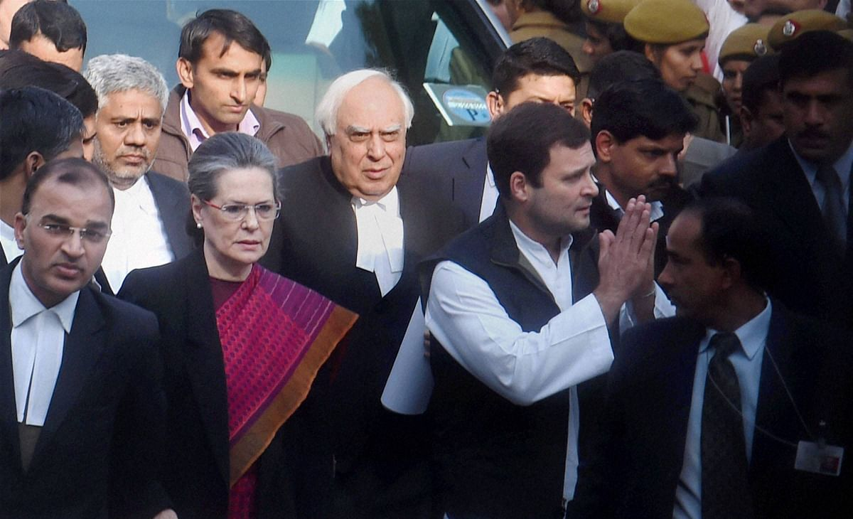 Congress President Sonia Gandhi and party Vice President Rahul Gandhi come out after attending a hearing in<i> The National Herald</i> Case at the Patiala House Courts. (Photo: PTI)