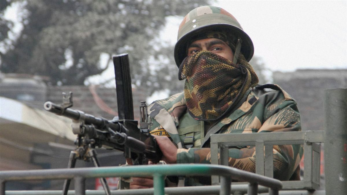 An army person stands guard during the operation against militants at the Indian Air Force base in Pathankot on Monday. (Photo: PTI)
