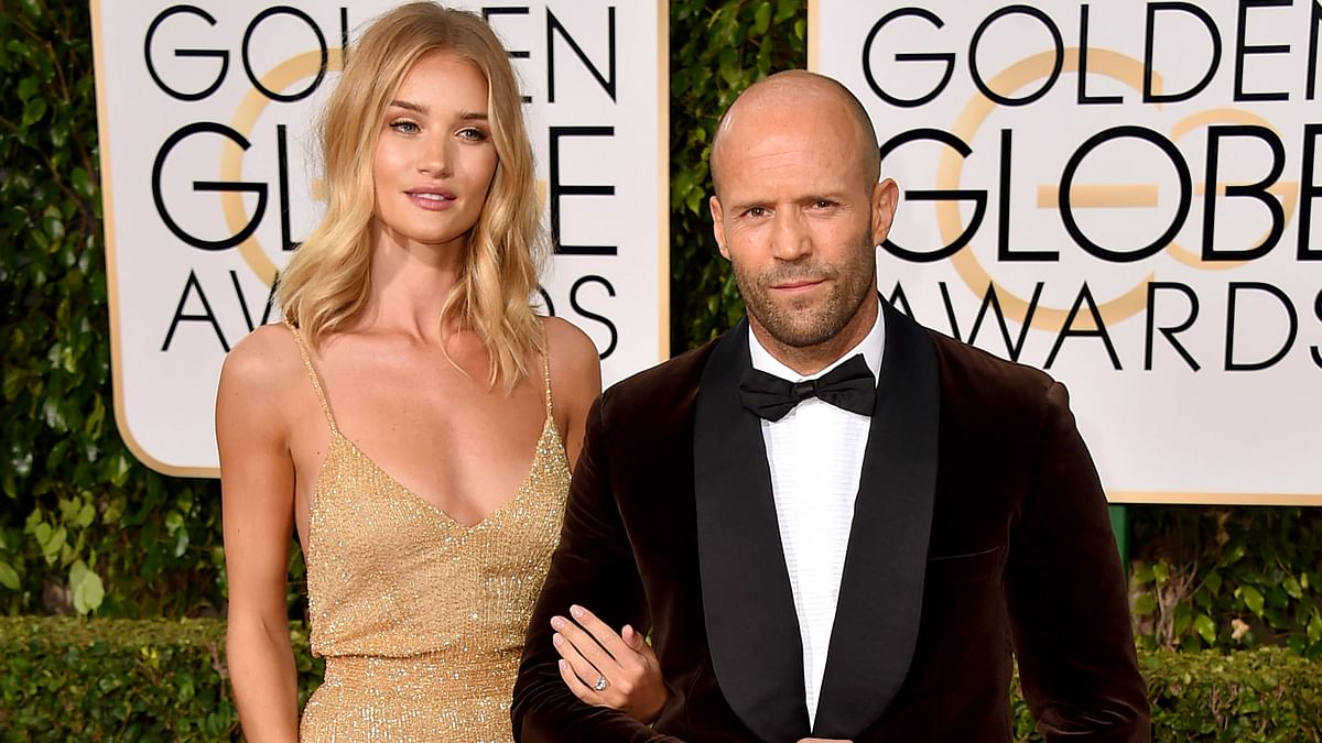 British model and actress Rosie Huntington-Whiteley, left, and Jason Statham arrive at the 73rd annual Golden Globe Awards in Los Angeles. (Photo: AP)