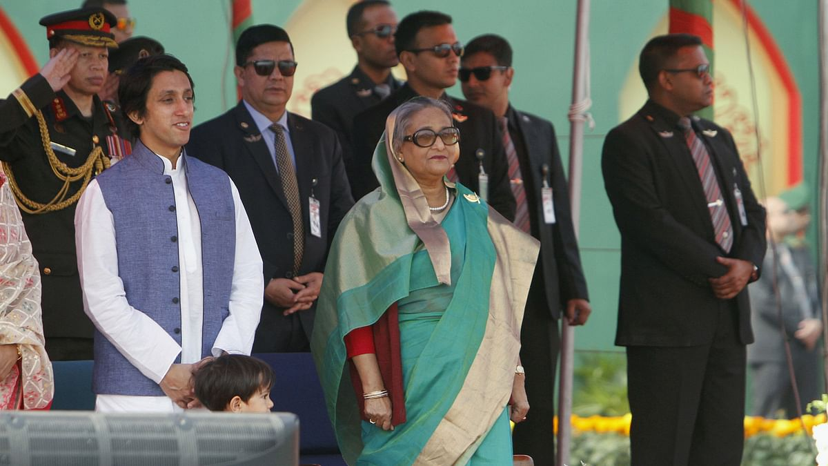 Bangladesh's Prime Minister Sheikh Hasina stands along with army officers for the national anthem during the celebration of the country's 45th Victory Day in Dhaka, December 16, 2015. (Photo: Reuters)