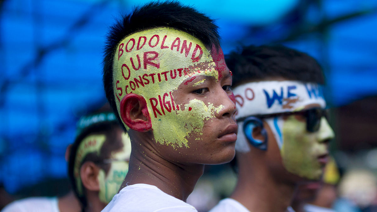 Supporters of Bodoland People's Front (BPF), a local political party, with their faces painted, attend a rally at Kokrajhar in the northeastern Indian state of Assam on August 4, 2013. (Photo: Reuters)