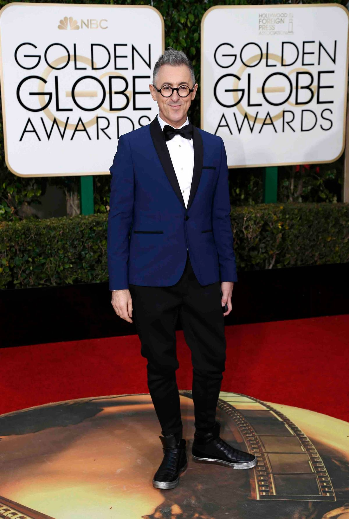 Alan Cumming in the indigo blue jacket brought a refreshing change to the red carpet (Photo: Reuters)