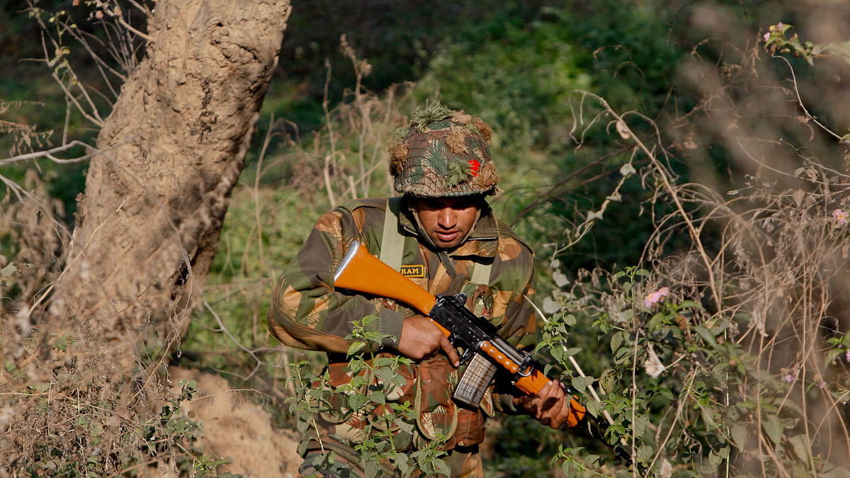 An army soldier is seen during a search operation in a forest area outside the Pathankot air force base in Punjab on Sunday, January 3, 2016. (Photo: AP)