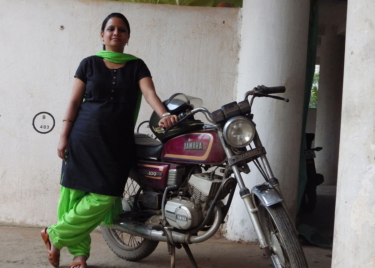 Sudatta and with her trusty second-hand Yamaha RX 100. (Photo: Sudatta Khuntia)