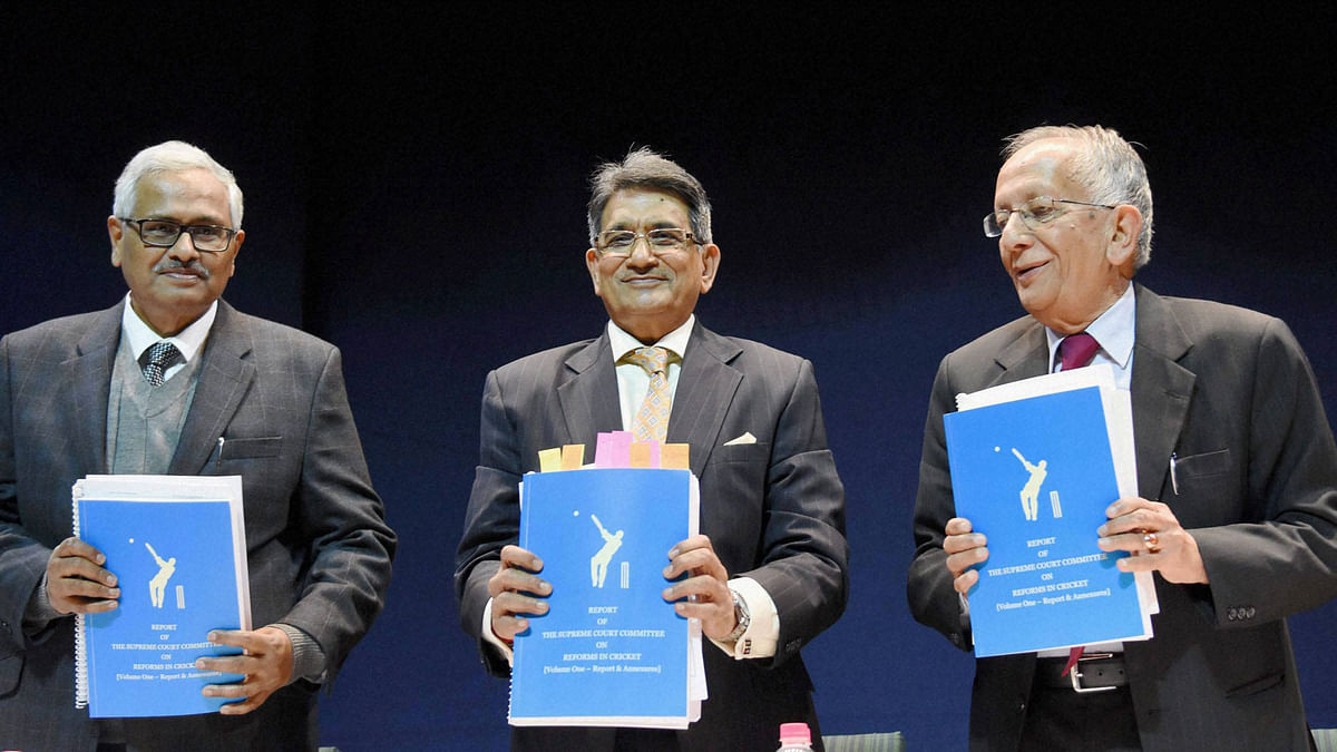 Chairman of the Supreme Court Committee on Reforms in Cricket Justice (retd.) R M Lodha with members Justice Ashok Bhan (R) and Justice R V Raveendran showing the copy of their report at a press conference in New Delhi. (Photo: PTI)