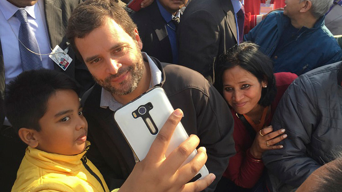 Rahul Gandhi' young follower clicks a selfie at a public event. (Photo:TheNewsMinute)