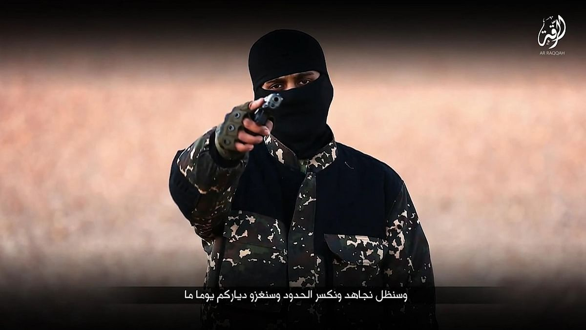 This snapshot from the video shows an ISIS member brandishing a gun and talking to the camera. (Photo: AP)