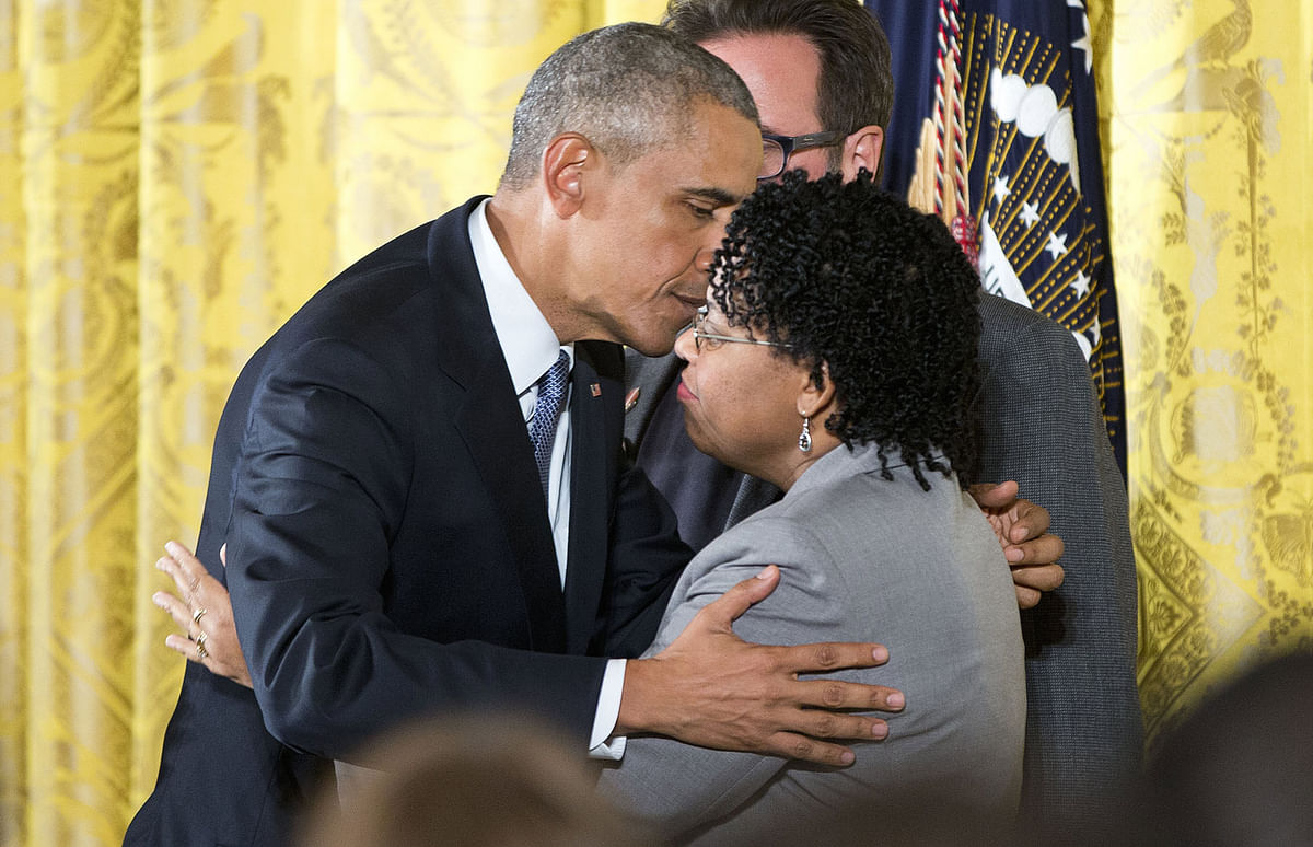 President Barack Obama embraces Jennifer Pinckney, wife of Reverend Clementa Pinckney, who was killed in the 2015 Charleston church shooting. (Photo: AP)