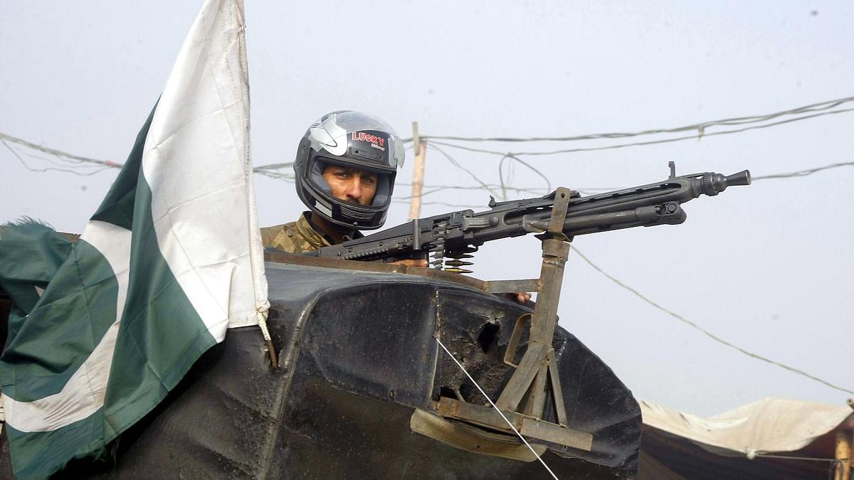 A Pakistani soldier takes aim outside the Bacha Khan university in Khyber-Pakhtunkhwa province of Pakistan on Wednesday, 20 January 2016. (Photo: IANS)