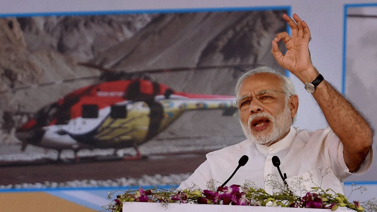 Prime Minister Narendra Modi speaks during the laying the foundation stone for HAL's new helicopter manufacturing facility at Biderehalla Kaval,Gubbi taluk, near Bengaluru on Sunday. (Photo: PTI)