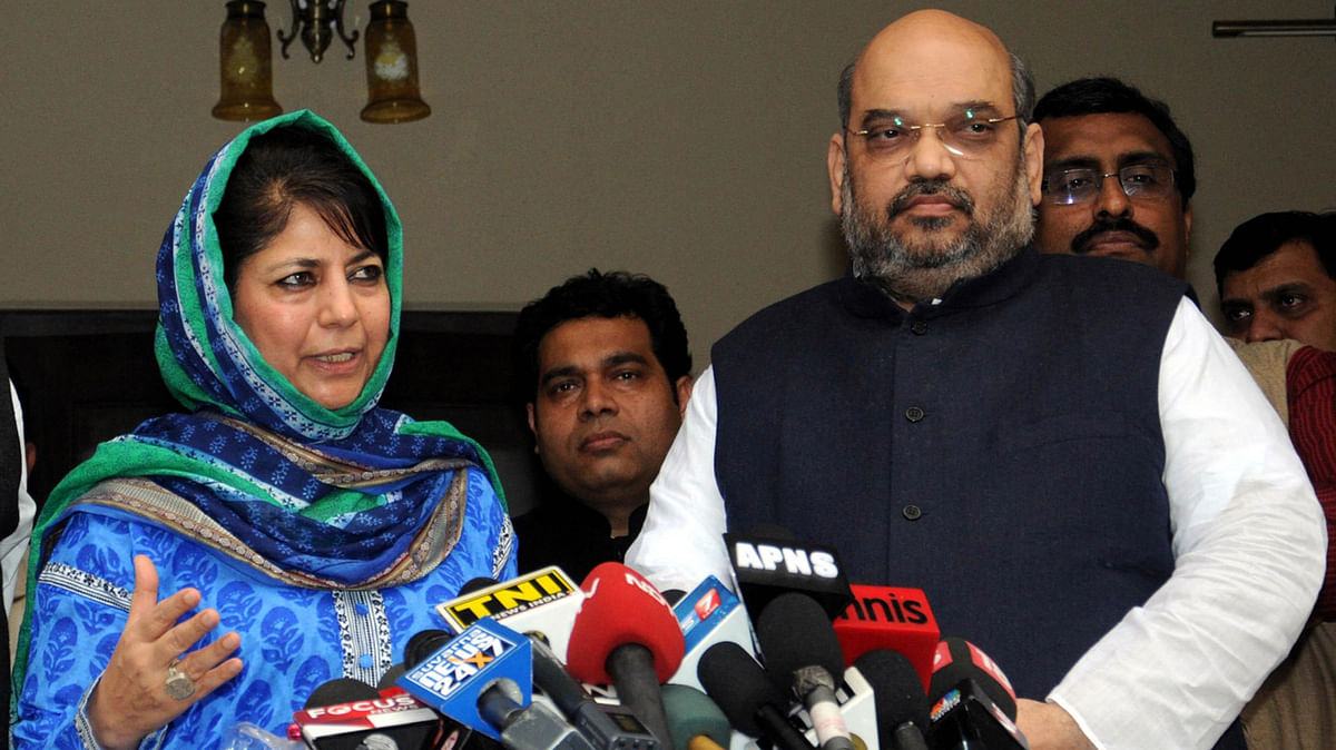File photo of Mehbooba Mufti and BJP President Amit Shah. (Photo: PTI)