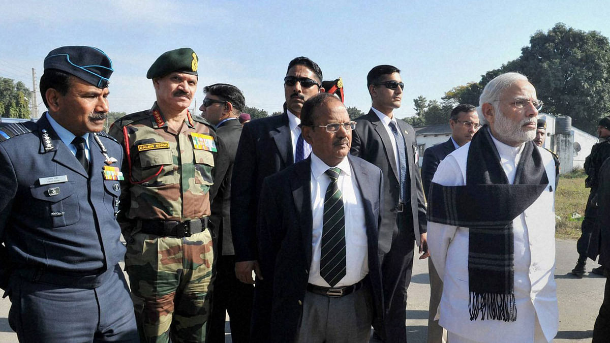 Prime Minister Narendra Modi and National Security Adviser Ajit Doval watching a presentation on counter-terrorist and combing operation by the Defence Forces, at Pathankot Airbase on Saturday. Chief of Army Staff General Dalbir Singh and Air Chief Marshal Arup Raha are also seen. (Photo: PTI)