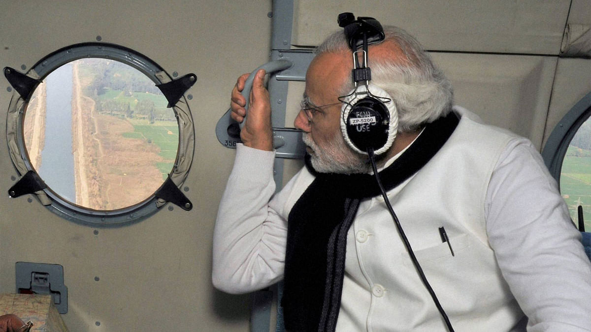 Prime Minister Narendra Modi conducting an aerial survey of the Pathankot air base. (Photo: PTI)