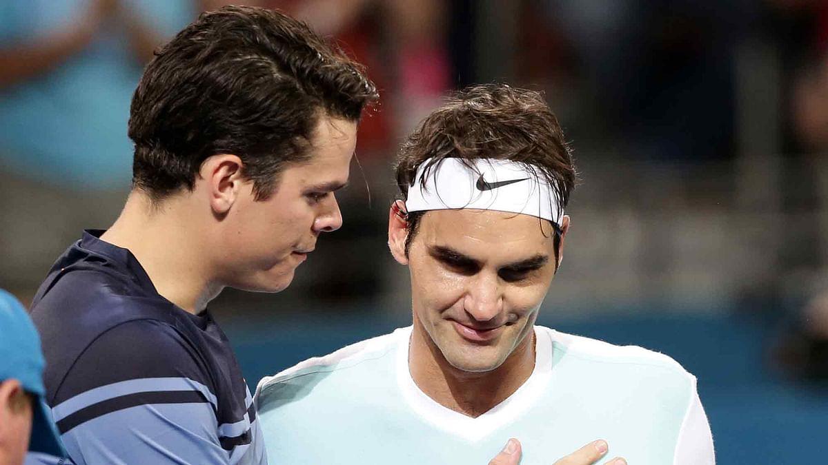 Milos Raonic speaks to Roger Federer after he won the Brisbane International men's final. (Photo: AP)