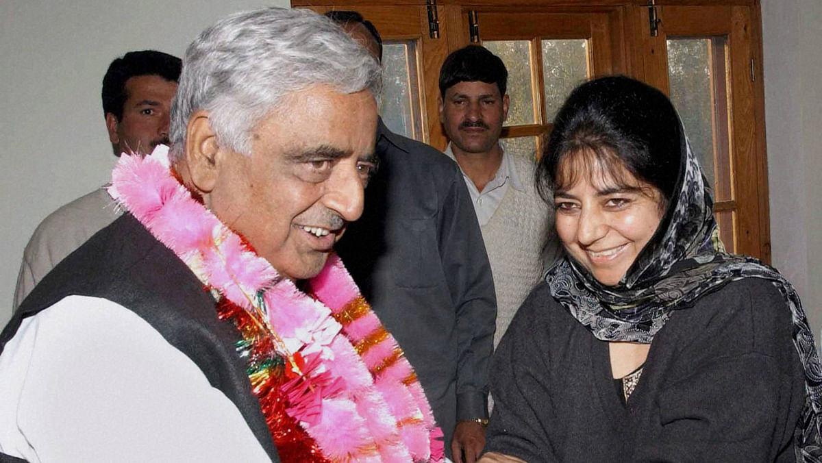 File photo of Mufti Mohammad Sayeed with his daughter Mehbooba Mufti during a meeting in Srinagar in October 2002.(Photo: PTI)