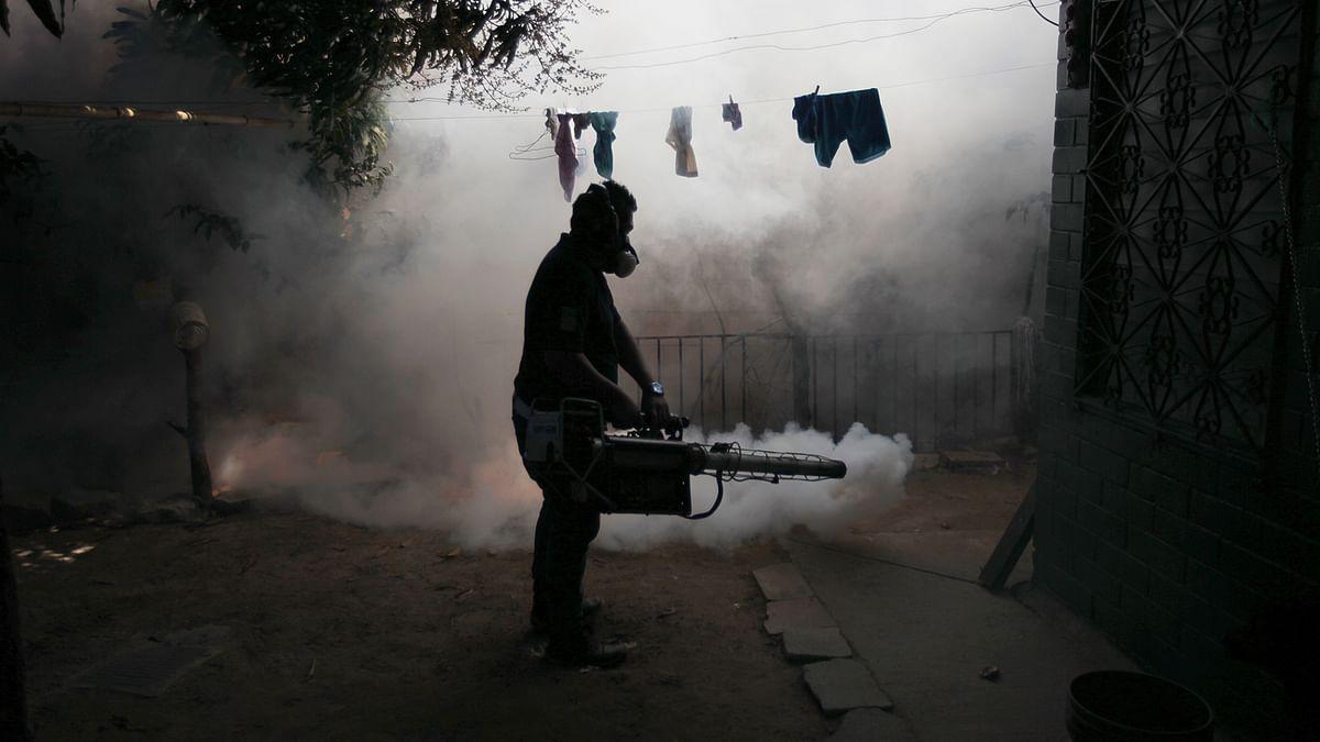 A health worker fumigates the Soyapango in El Salvador. (Photo: Reuters)