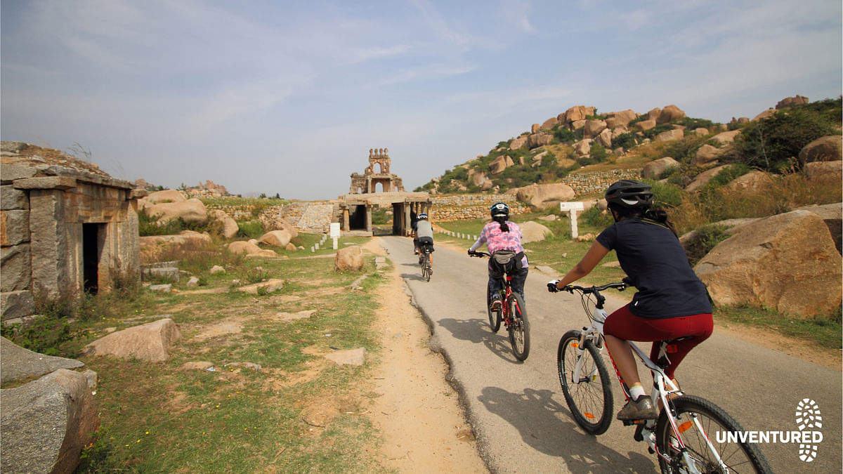 A photo taken during the picturesque Hampi cycle trail is ample proof of why you should pick up a bicycle now! (Photo Courtesy: Unventured)