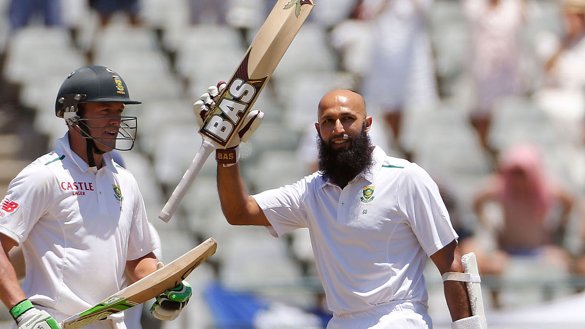 South African Hashim Amla reacts after scoring one of his centuries  during their second Test against England in Cape Town. (Photo: AP)<a></a>