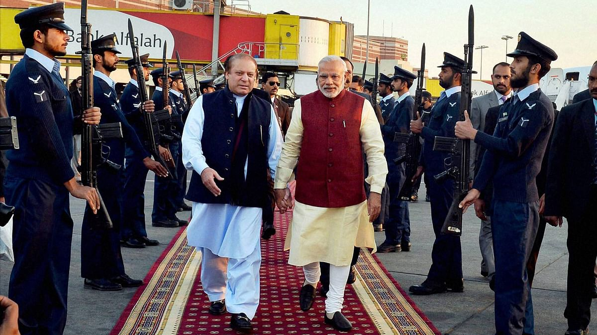 Prime Minister Narendra Modi is received by his Pakistani counterpart Nawaz Sharif upon his arrival in Lahore, December 30, 2015. (Photo: PTI)