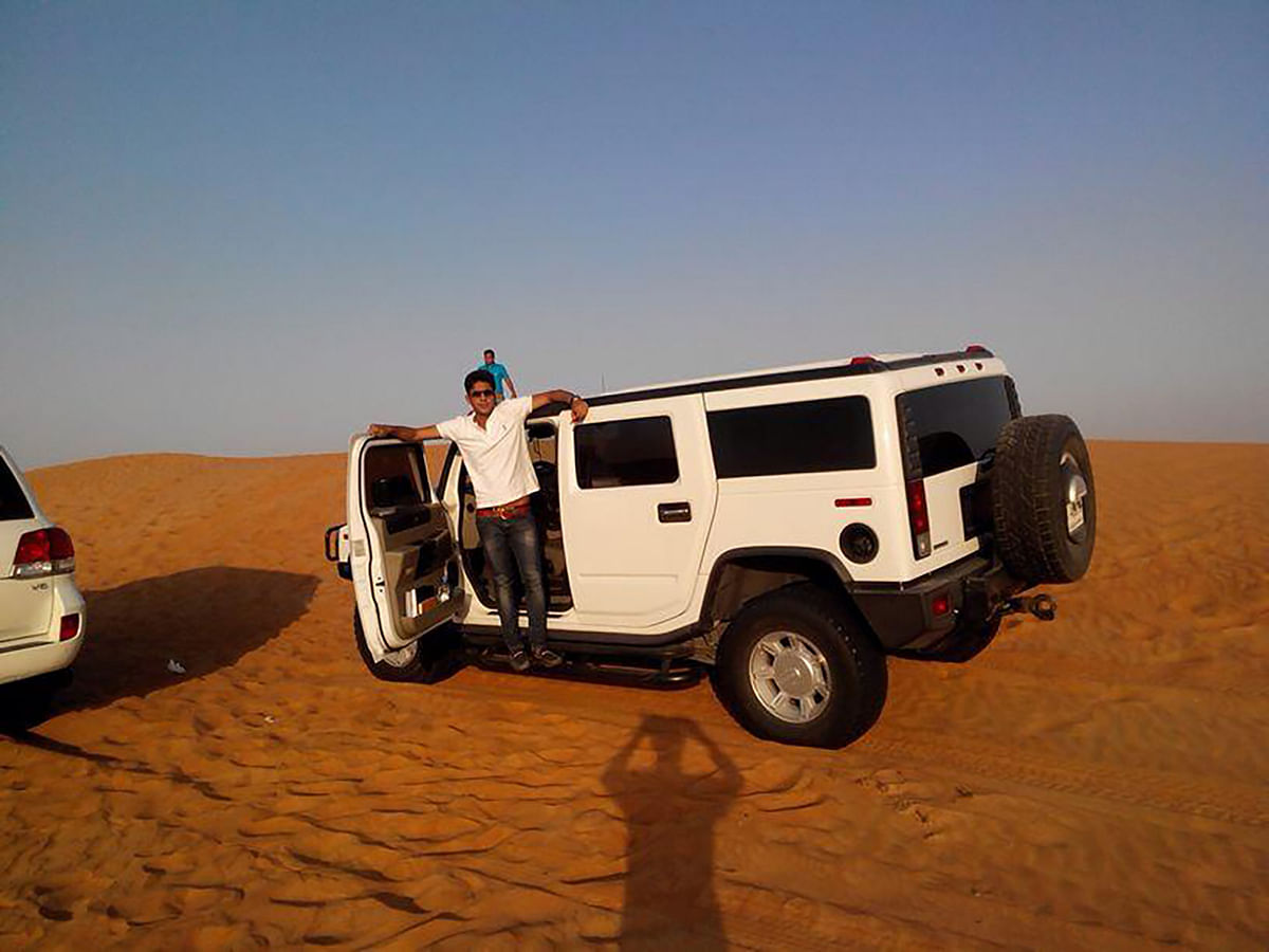 """Ambia with his white hummer. (Photo: <a href=""""https://www.facebook.com/photo.php?fbid=534143153320738&amp;set=a.303481266386929.65638.100001751742452&amp;type=3&amp;theater"""">Facebook</a>)"""