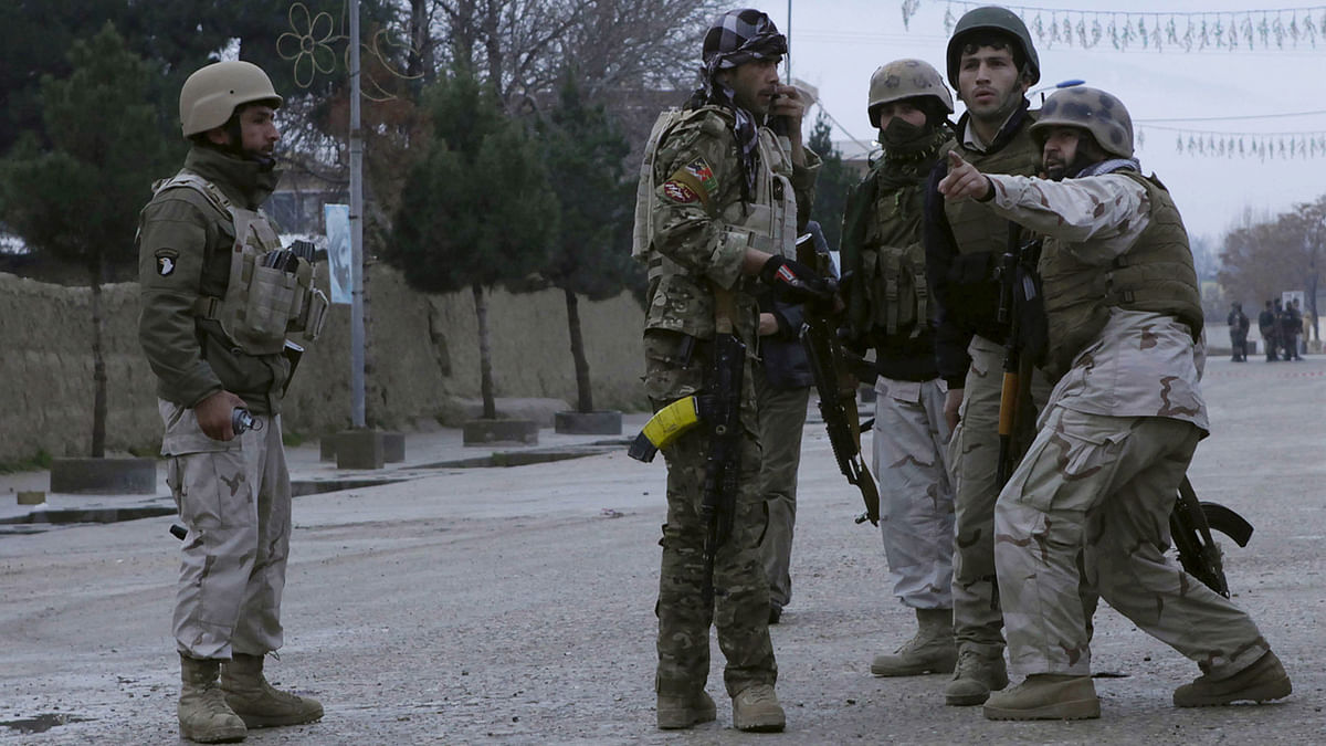 """Members of the Afghan Quick Reaction Force (QRF) talk among themselves during an operation near the Indian consulate in Mazar-i-Sharif, Afghanistan on Monday. (Photo: Reuters)<a href=""""http://www.thequint.com/section/World""""></a>"""