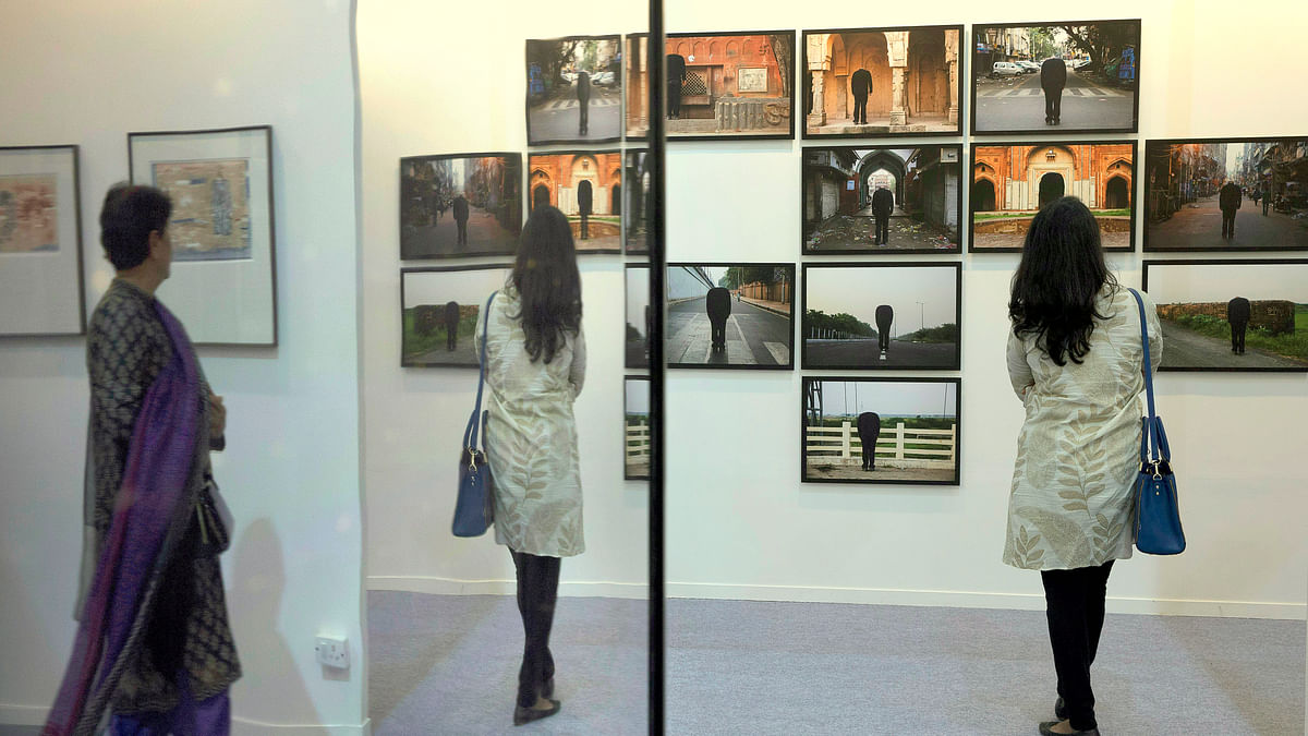 "Art enthusiasts look at art work titled ""Looking For Dvaipayana"" by Atul Bhalla, at India Art Fair, in New Delhi. (Photo: AP)"