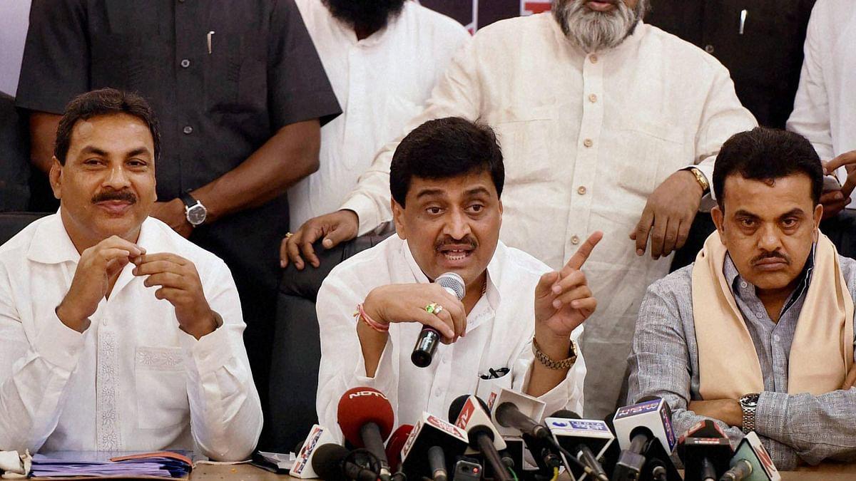 <p>Maharashtra Congress leader Ashok Chavan (centre) at a press conference.&nbsp;</p>