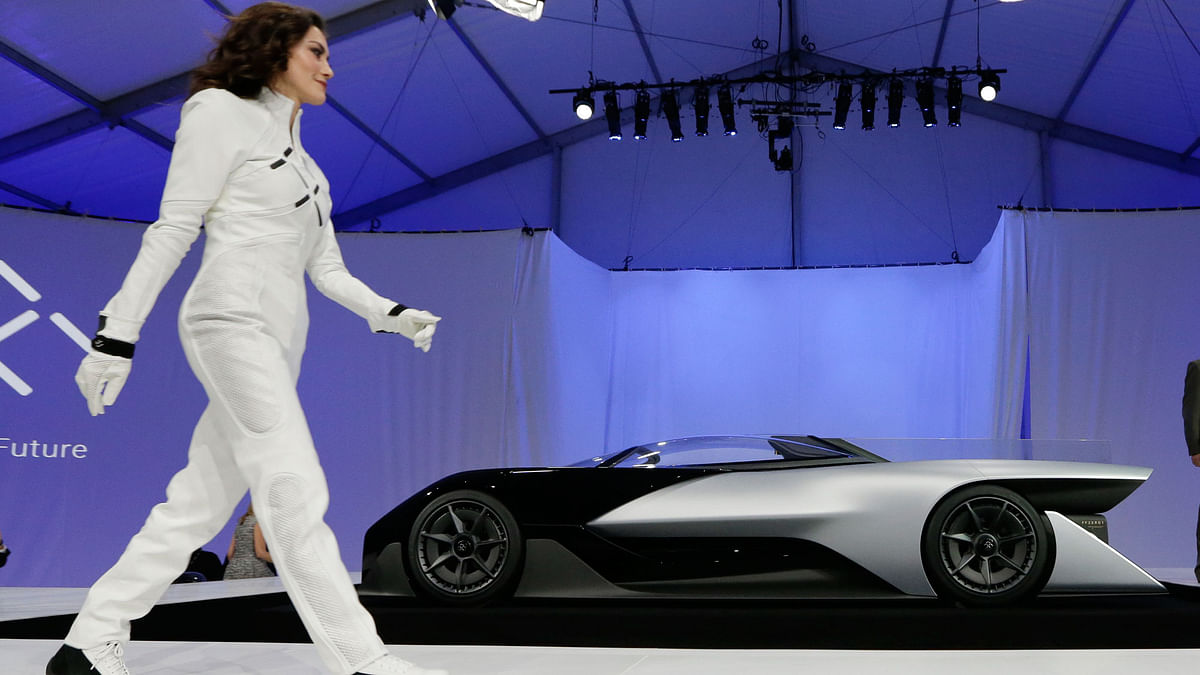 A driver walks in front of the FFZero1 by Faraday Future at CES Unveiled, a media preview event for CES International Monday, Jan 4, 2016, in Las Vegas.  (Photo: AP)