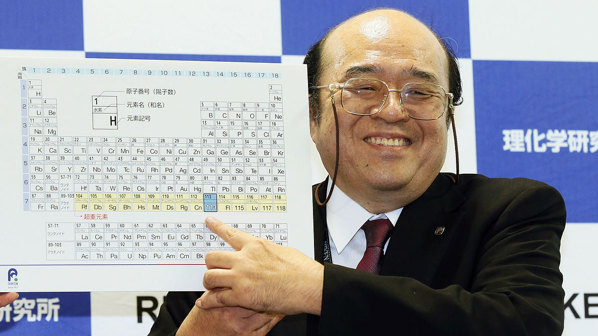 Kosuke Morita of Riken Nishina Center for Accelerator-Based Science points at periodic table of the elements. (Photo: AP)