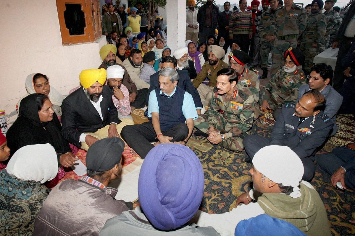 Union Minister for Defence Manohar Parrikar along with the Air Chief Marshal Arup Raha and the Chief of Army Staff, General Dalbir Singh offering condolences to the family of the late Lance Naik Kulwant Singh at Chak Sarif village in Gurdaspur on Wednesday. (Photo: PTI)