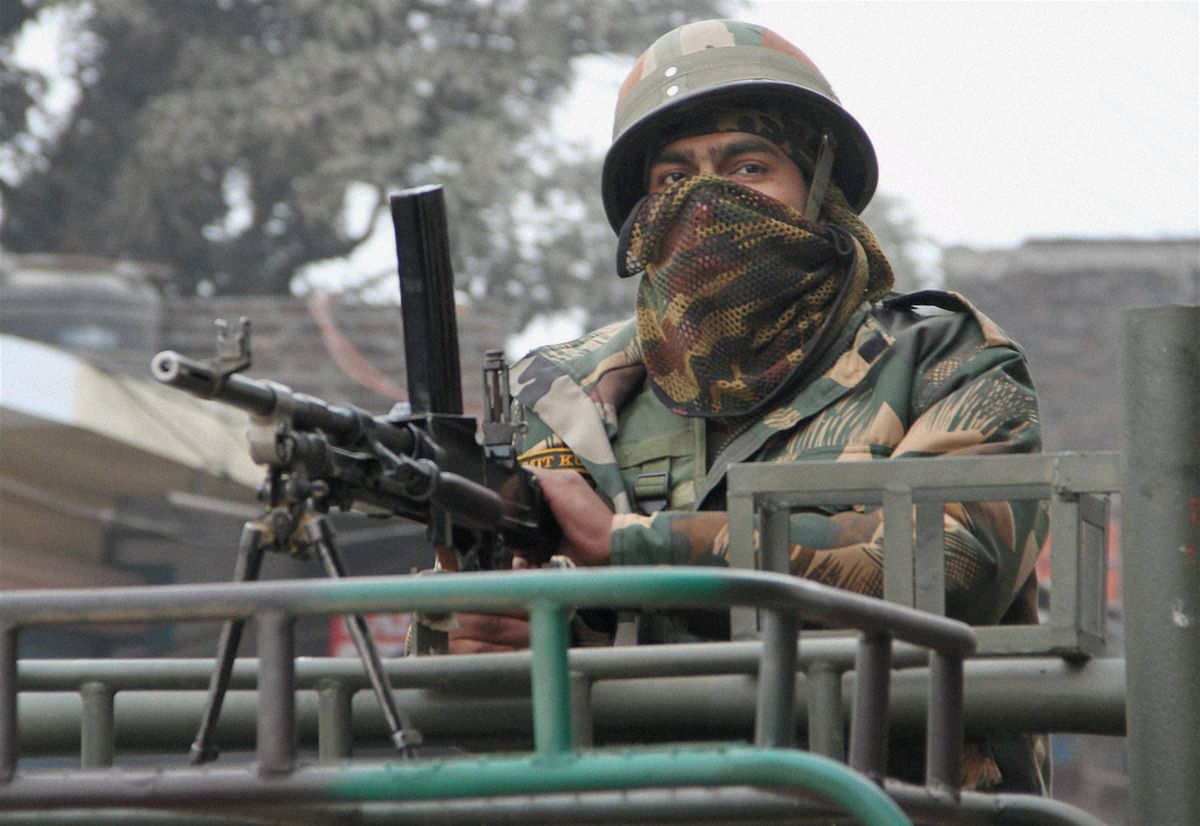 An army person guards during the operation against the militants at the Indian Air Force base in Pathankot. (Photo: PTI)