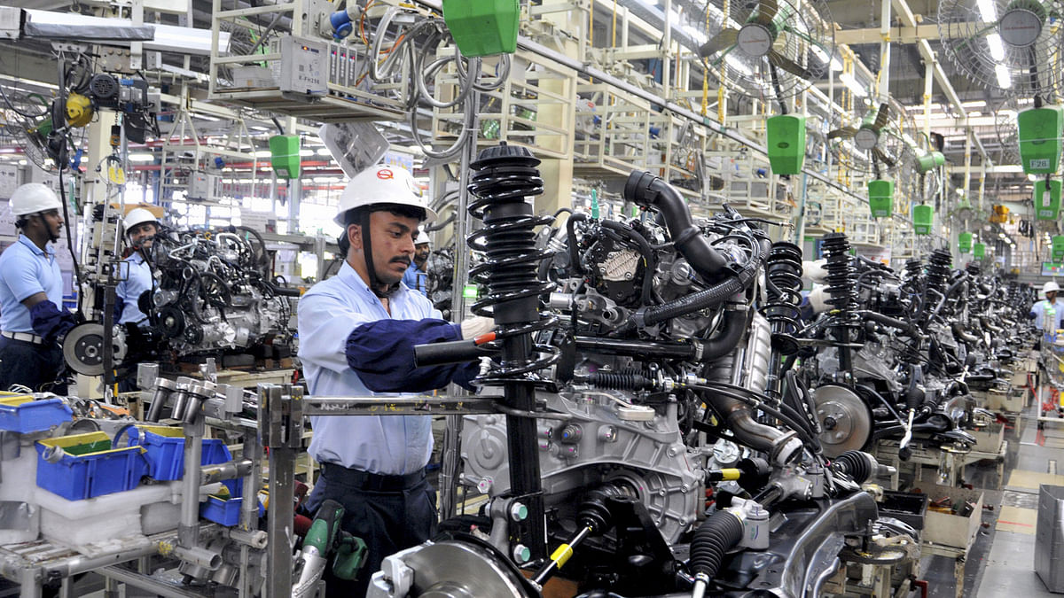 An employee works on Toyota car engines inside the manufacturing plant of Toyota Kirloskar Motor in Bidadi, on the outskirts of Bengaluru, 2015. (Photo: Reuters)